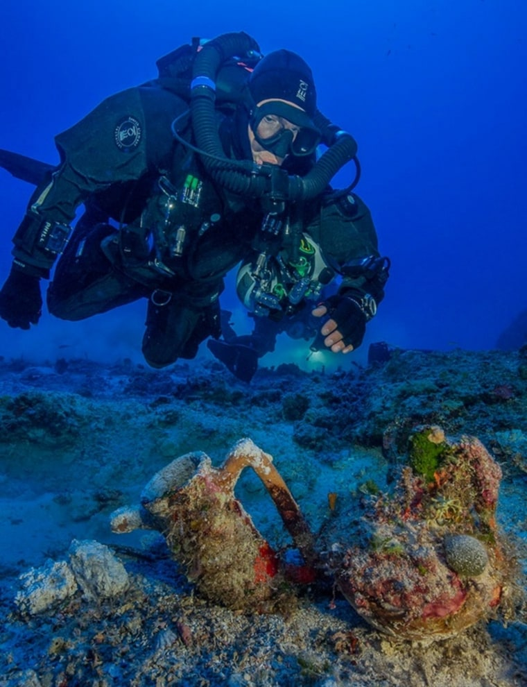Image: Archaeologist swims over artifacts at site of Antikythera shipwreck