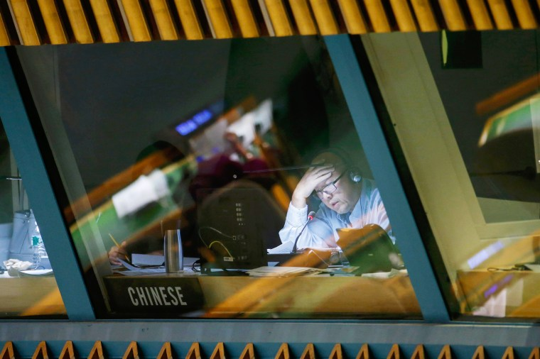 Image: An interpreter works in a booth translating the addresses delivered by world leaders during the 70th session of the United Nations General Assembly at the U.N. Headquarters in New York