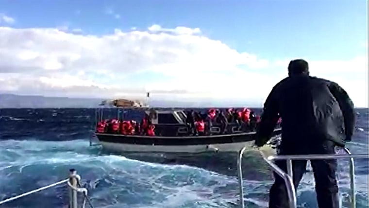 Image: Fishing boat carrying migrants and refugees off Lesbos, Greece