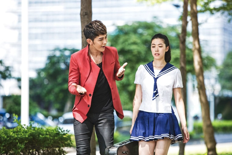 """Sarah Chang on the set of """"The Crossing Hero"""" with Jiro Wang."""