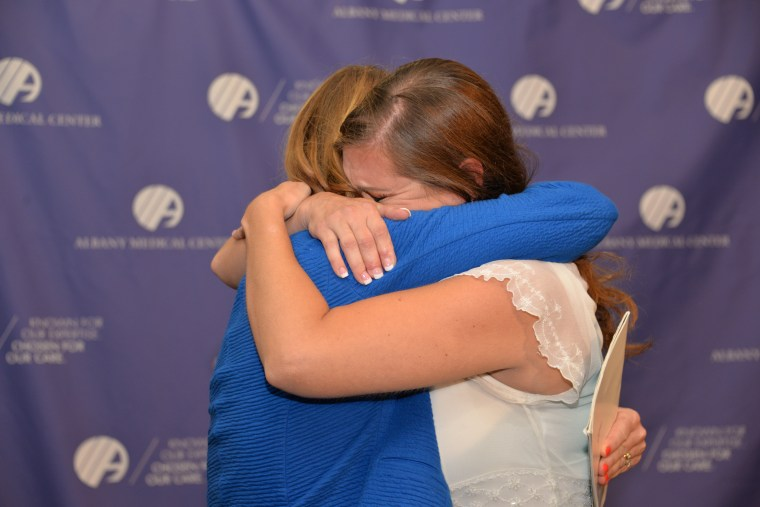 Amanda Scarpinati and nurse Sue Berger meet in an emotional reunion at the Albany Medical Center.