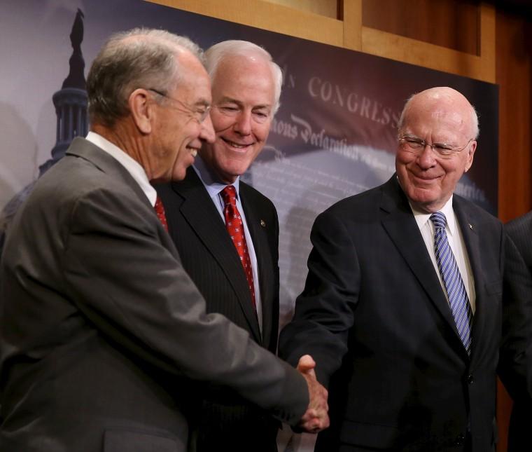 Image: Senators Grassley, Cornyn and Leahy shake hands at news conference on criminal justice reform in Washington