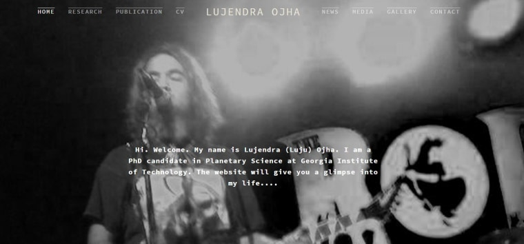 A screenshot of Lujendra Ojha's personal website, which features him playing guitar.