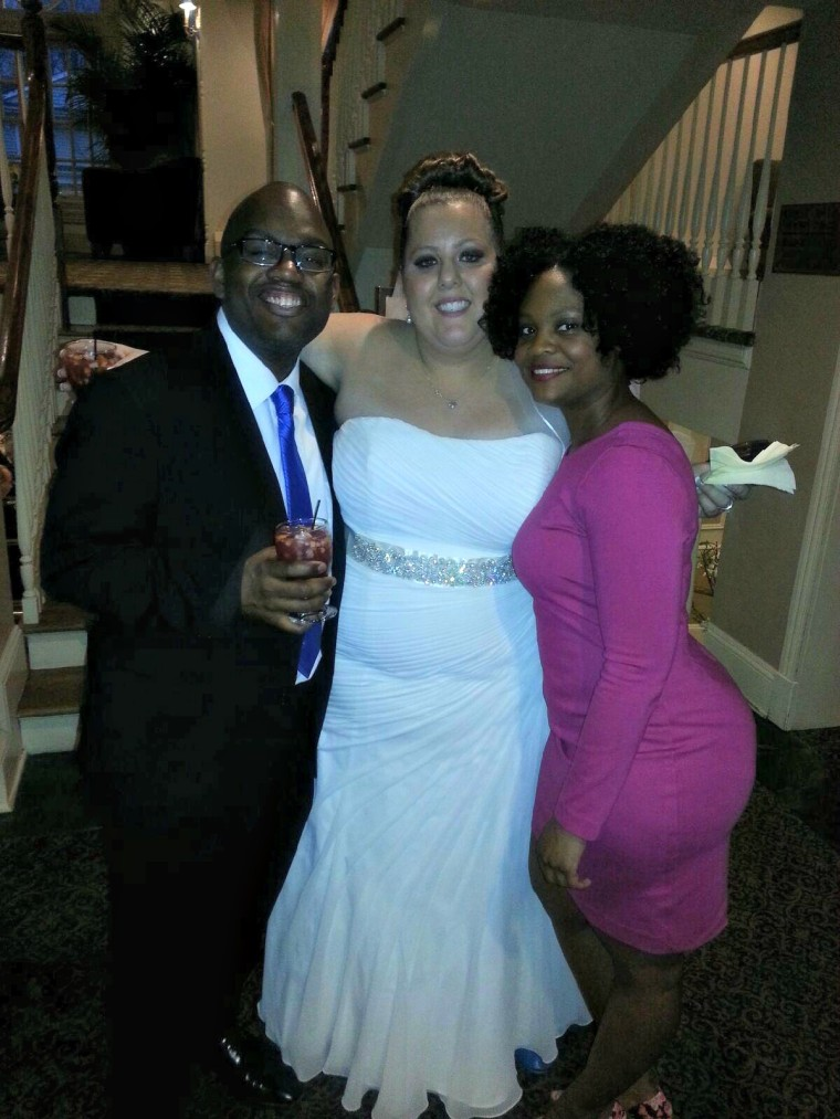 Dan-el and Missy on their wedding day in March 2015. The couple is posing with Missy's friend Jazneigh Beamon.
