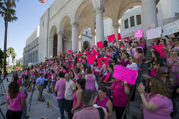 "Image: Activists rally in support of Planned Parenthood on ""National Pink Out Day"" on the steps of City Hall in Los Angeles"