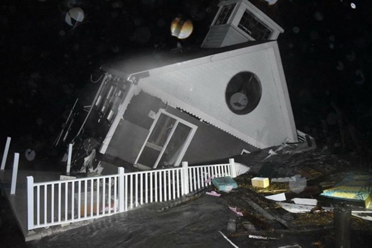 A house collapses into the bay in Wildwood, New Jersey, early on Oct. 3