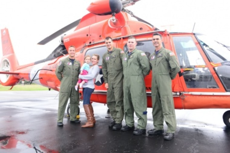 Cristi Mueller, her infant daughter and the Coast Guard crew that rescued them.