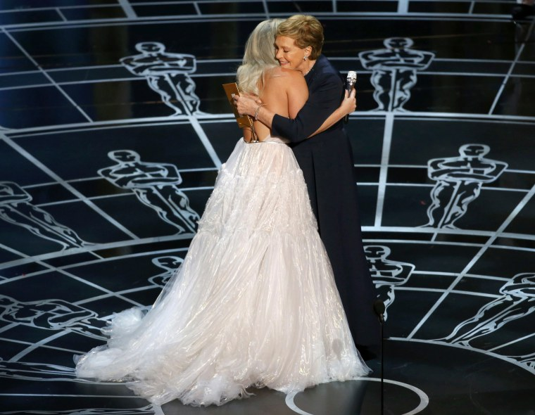Julie Andrews hugs Lady Gaga after she performed songs from the Sound of Music at the 87th Academy Awards in Hollywood, California