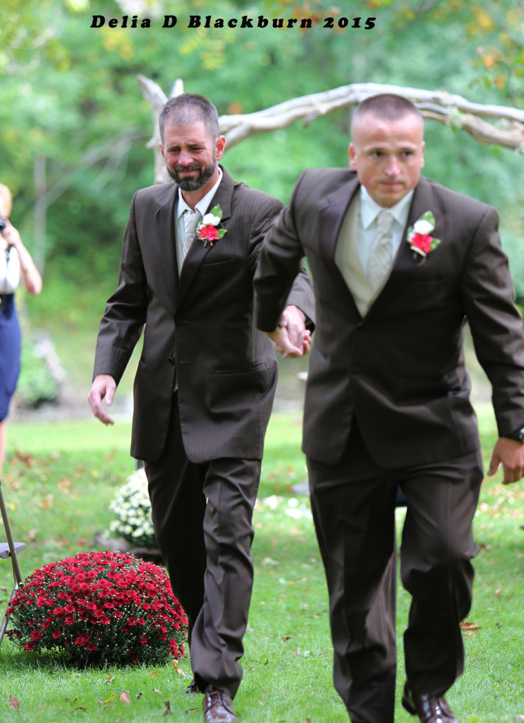 Dad surprises stepdad at daughter's wedding — with both walking bride down aisle