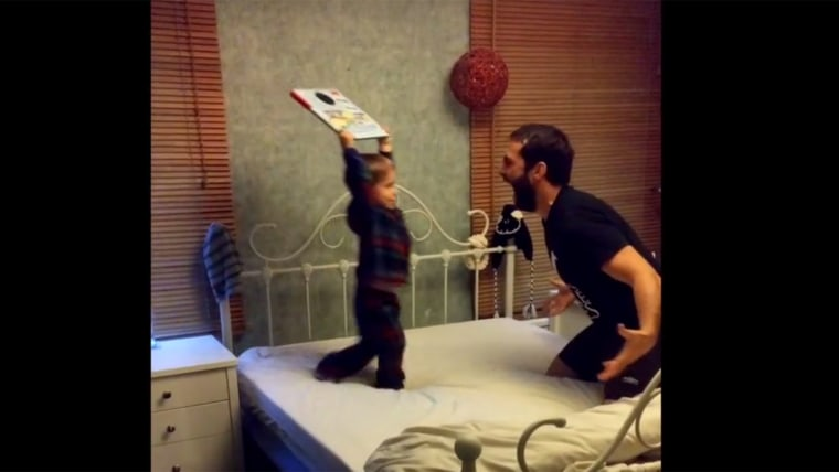 Dad and son have a playful wrestling match