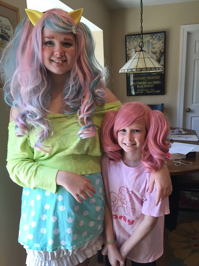 Alice, 14, and Daisy, 10, dressed up for Halloween last year. Alice hasn't stopped going out for the holiday even though she's a teen.