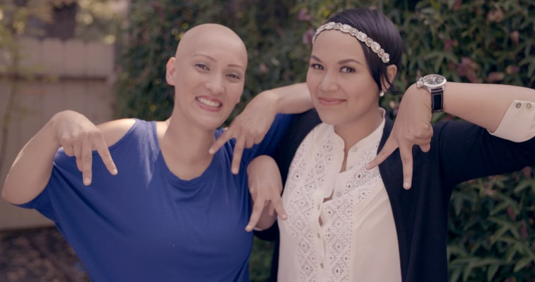 Rachel, left, and Abby met through a Facebook group. Here they're making the alopecia awareness sign.