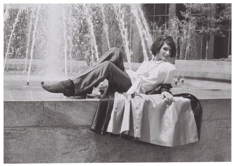 Sylvia Rivera in front of fountain in 1970.