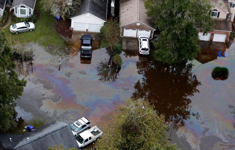 Image: An oil sheen covers flood waters in South Carolina