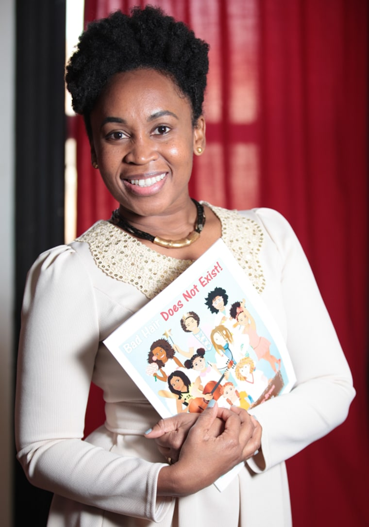 """Sulma Arzu-Brown poses with her book """"Bad Hair Does Not Exist! Pelo Malo No Existe!"""""""