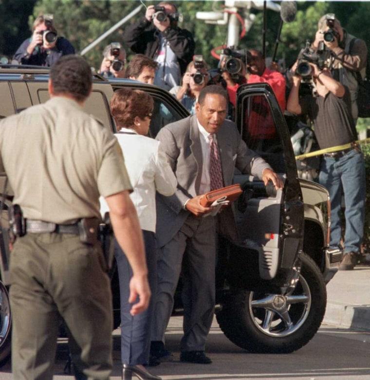 Defendant O.J. Simpson arrives under the gaze of t