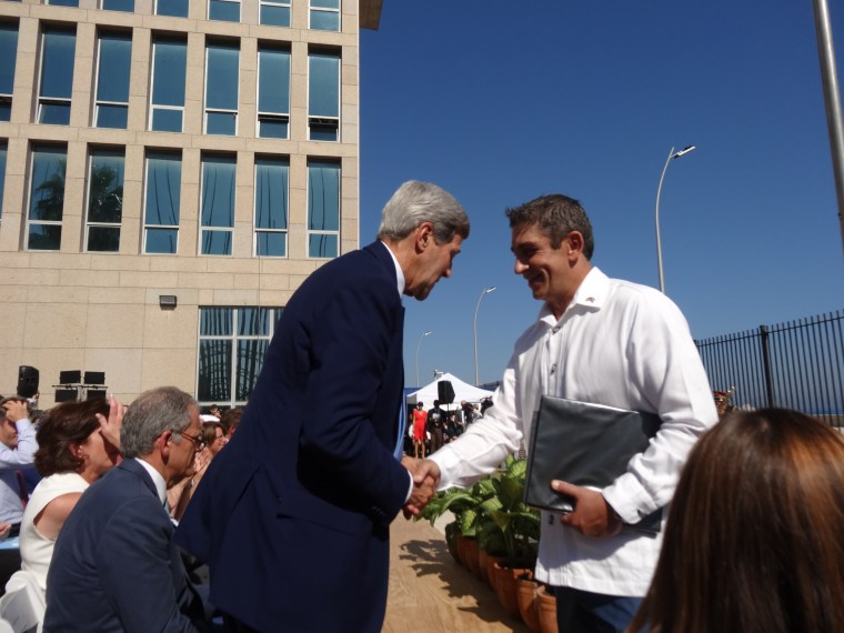 """Cuban-American poet Richard Blanco shook hands with Secretary of State John Kerry after reciting his poem titled """"Matters of the Sea"""" on August 14, 2015, during the reopening ceremony of the U.S. embassy in Havana, Cuba."""