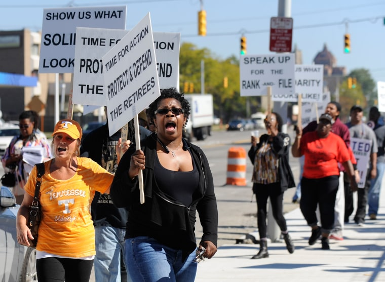 Image: Protesters picket outside UAW Solidarity House