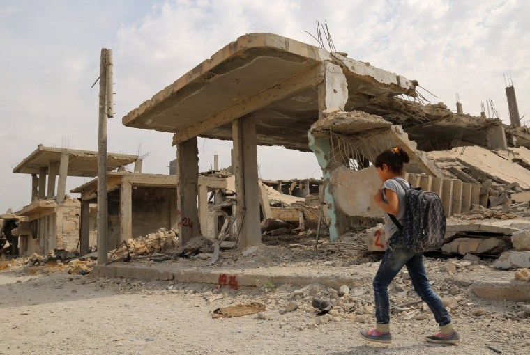 Image: A girl heads to school in Kobani, Syria, on Oct. 6