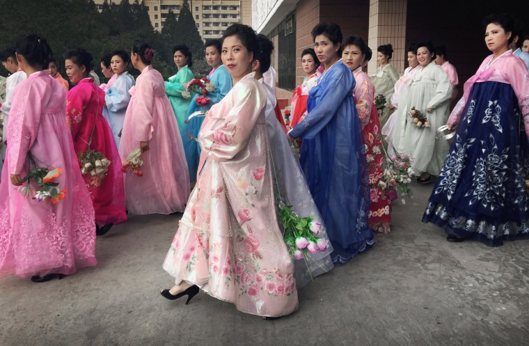 Image: Women rehearse for the 70th anniversary of the founding of North Korea's Communist party