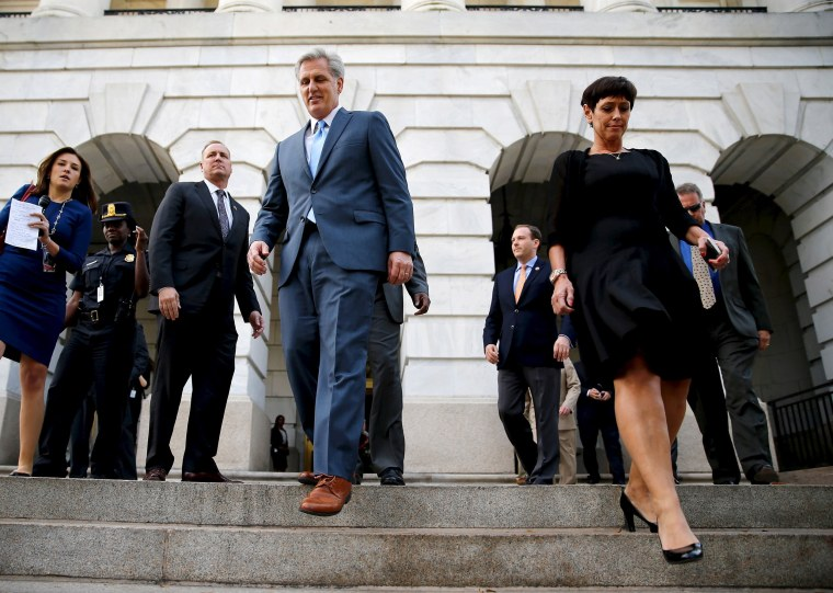 Image: McCarthy and his wife depart after his decision to pull out of a Republican caucus secret ballot vote to determine the nominee to replace retiring House Speaker John Boehner, on Capitol Hill in Washington