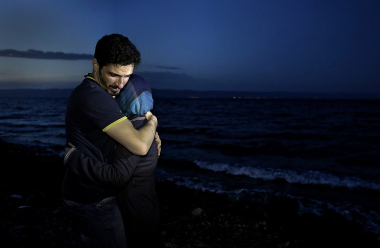 Image: Refugees and migrants arrive on the Greek island of Lesbos