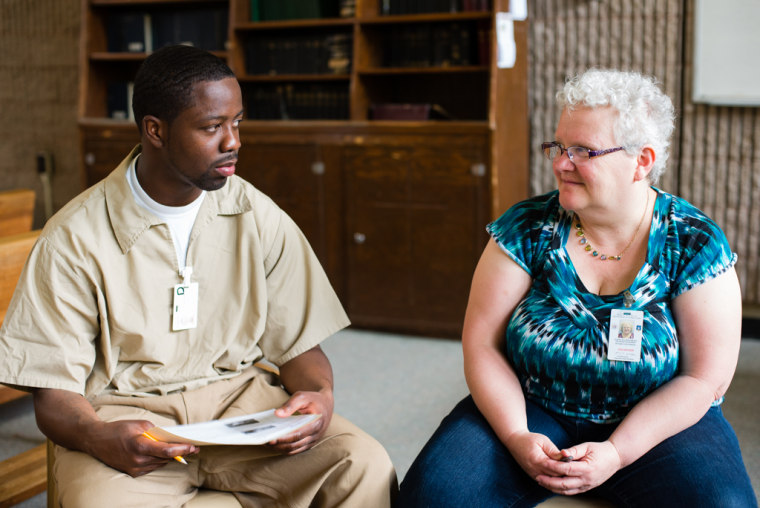 April 22, 2015 - Leesburg, NJ. Hakeem Roberson, 28, sits with Heart-to-Heart program assistant Susan Weiss, who helped facilitate a small group. Weiss, a longtime student and now trainer in nonviolent communication, has been with the program since its inception.