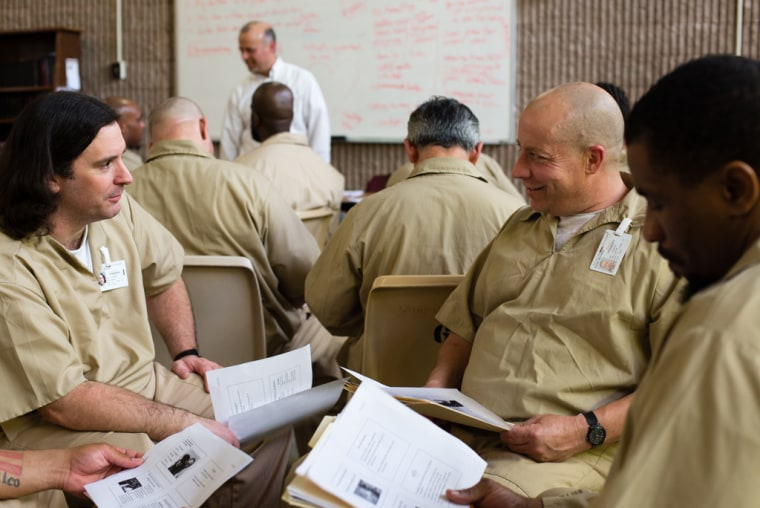 """April 22, 2015 - Leesburg, NJ. Matthew Thoms, right, discusses the day's prompt with fellow students in a small group.   """"I use non-violent communication skills on a regular here at Bayside,"""" Thoms said. """"It has brought me to a place where I can learn and reflect in prison."""" Asked what he wanted people know know about life behind bars, he said, """"I want people to know incarceration doesn't change you, you have to deep down want to change."""""""