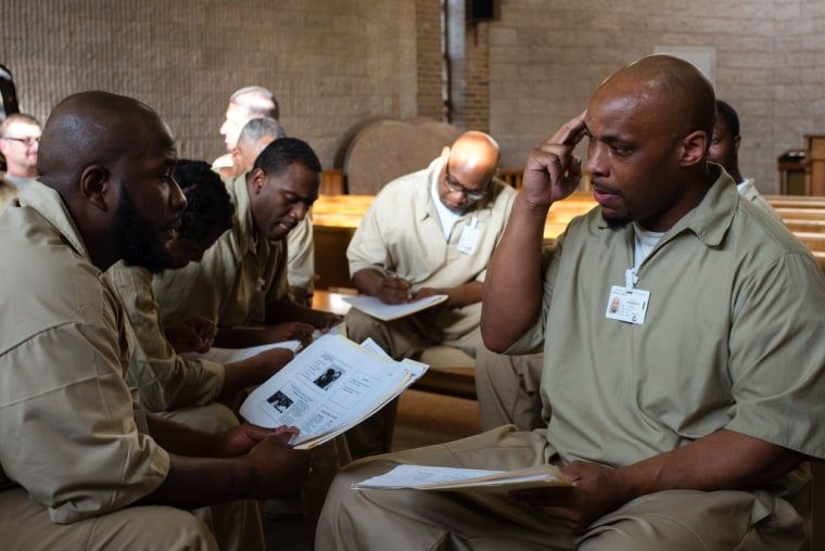 """April 22, 2015 - Leesburg, NJ. In the second half of the class, men gathered into small groups. Tumolo asked them to try to identify the choices that led to their incarceration.   Curtis Jones, left, leans in as Rafiq Grundy speaks.   """"Heart to heart has reinforced a lot of concepts I already know,"""" said Grundy, 36. """"Like how we are all the same in a lot of ways. That we all want peace. In that, my sense of compassion has grown.""""  """"I've learn that everybody's feeling is valid,"""" said Jones, 37. """"It brought me to a point into my life where I've learn how to meditate."""""""