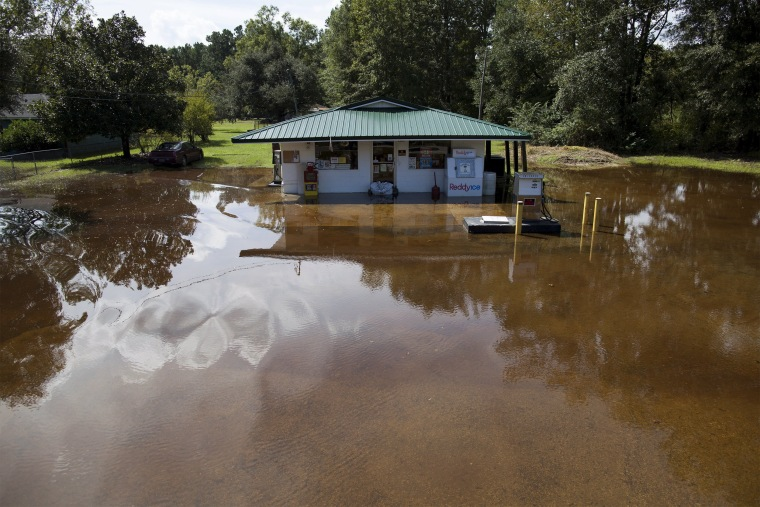 Image: Community store in the Dunbar Community is surrounded by water in Georgetown