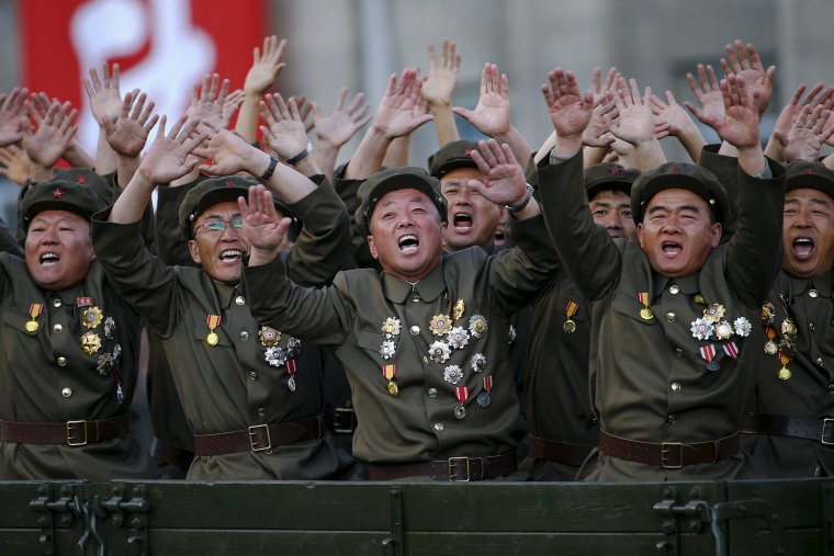 Image: Veteran soldiers react as their truck drives past a stand with North Korean leader Kim Jong Un during the parade celebrating the 70th anniversary of the founding of the ruling Workers' Party of Korea, in Pyongyang