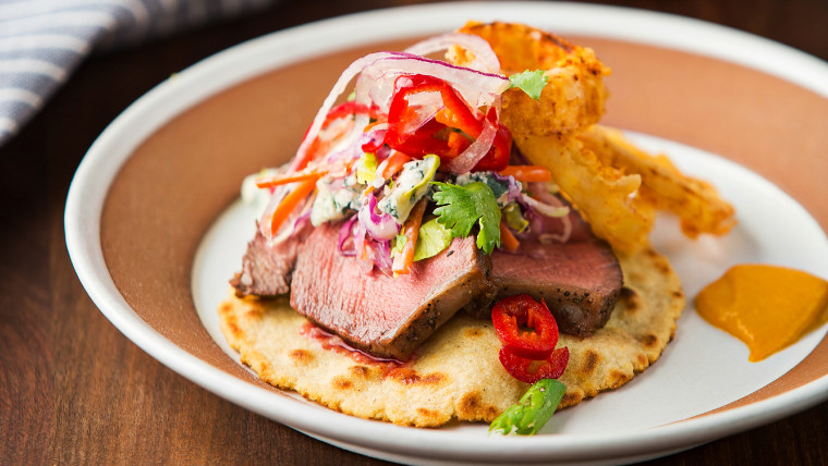 Beef tenderloin tacos with blue cheese slaw and crispy onions