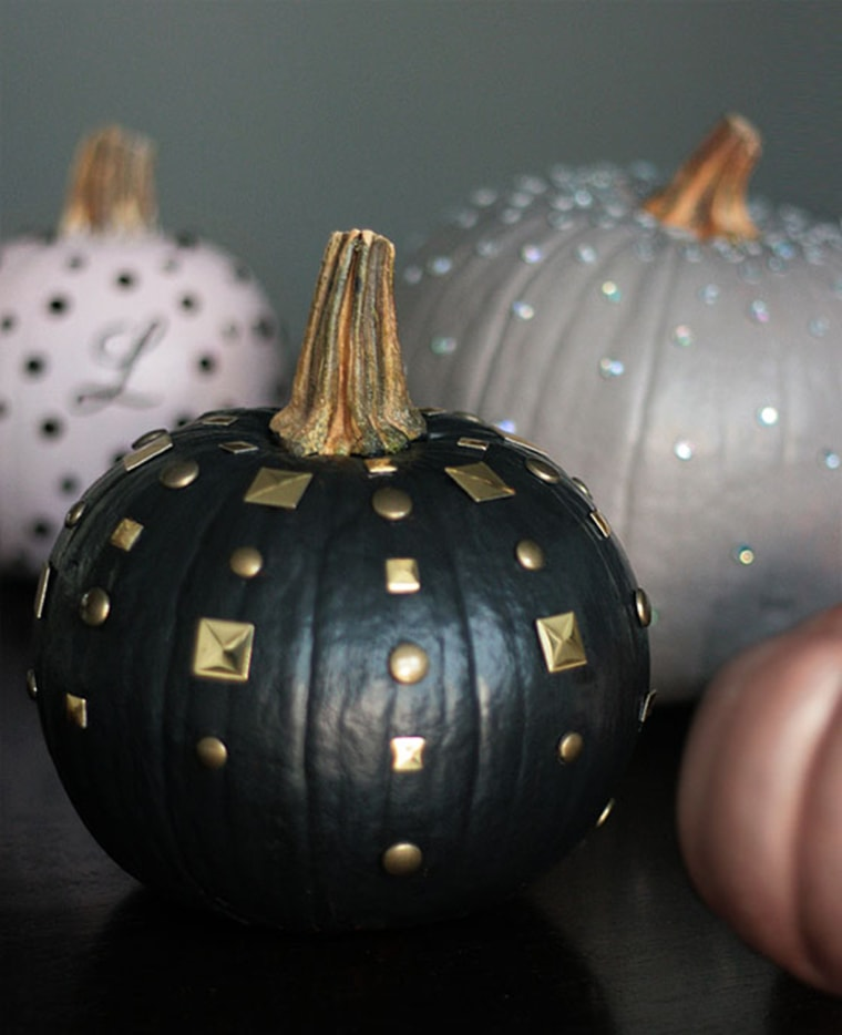 Fall decorating black pumpkin with studs