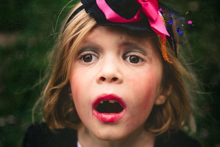 """""""No kid wants to pose for a photo when the candy is calling.  But before Halloween, they will do anything for the opportunity to put on their costume,"""" says photographer Rebecca Wyatt."""