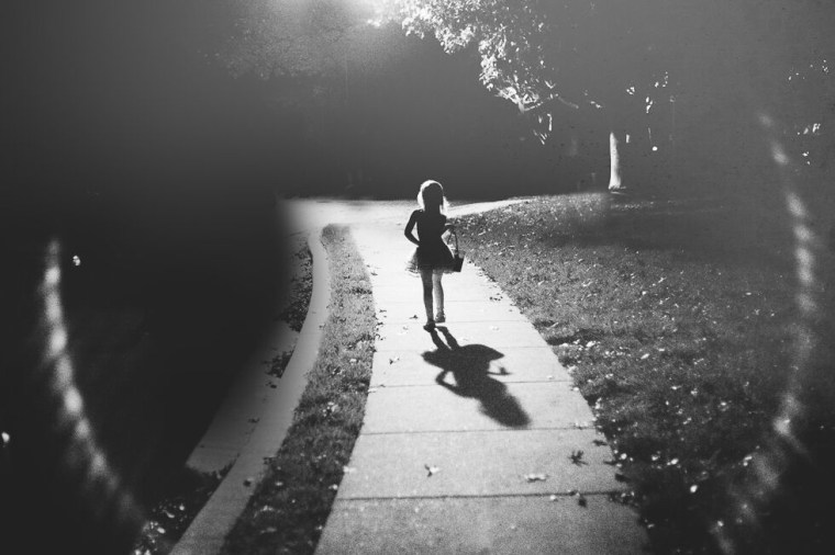 A black and white photo in the dark can be quite dramatic.