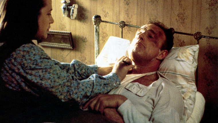 MISERY, from left: Kathy Bates, James Caan, 1990, © Columbia/courtesy Everett Collection
