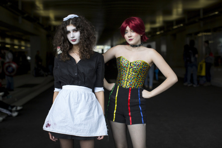 Image: Olivia Alicandri dressed as Magenta and Olivia Viteznik dressed as Columbia, both characters from Rocky Horror Picture Show, pose for photos on day two of New York Comic Con in Manhattan, New York