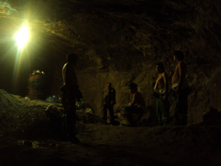 Image: Chilean trapped miners gather inside the San Jose mine as the rescue operation starts in Copiapo