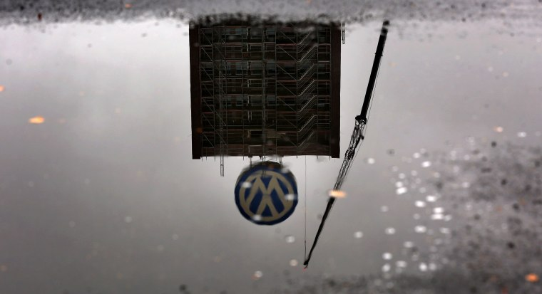 Image: Volkswagen headquarters reflected in puddle