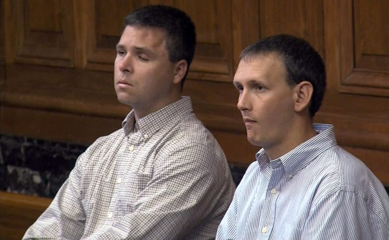 Milwaukee police officer Bryan Norberg, right, and Officer Graham Kunisch in a Milwaukee courtroom testifying against Badger Gun Store where a illegally purchased gun was used to  shoot both officers during an arrest.