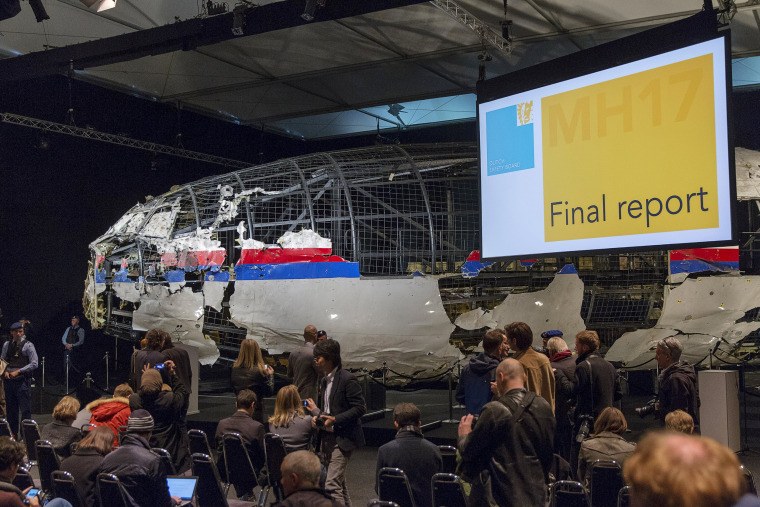 Image: Reconstructed airplane serves as a backdrop during the presentation of the final report into the crash of July 2014 of Malaysia Airlines flight MH17 over Ukraine, in Gilze Rijen, the Netherlands