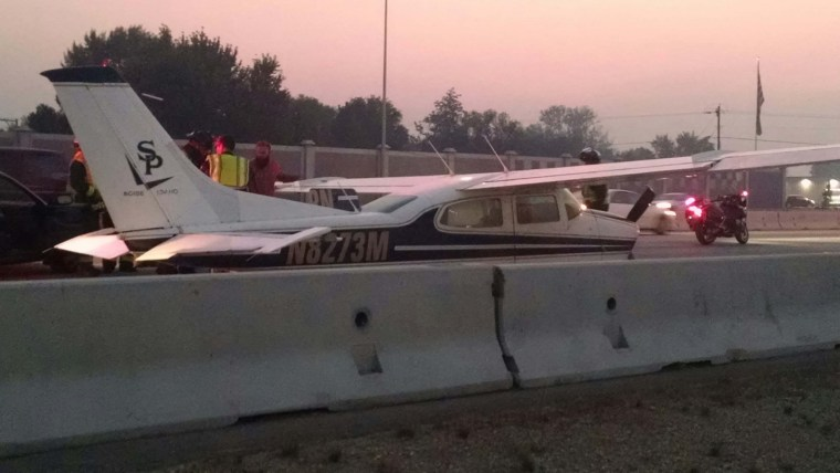 Image: A small aircraft lands on interstate