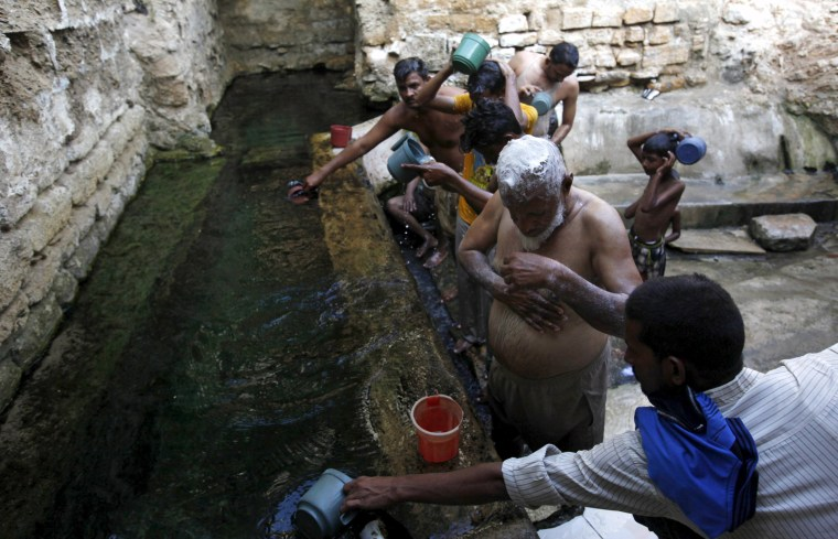 Image: People bathe with spring water