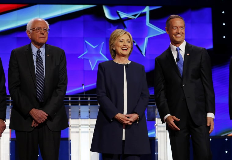 Image: Democratic presidential candidates Sanders, Clinton and Governor O'Malley stand together onstage before the start of the first official Democratic candidates debate of the 2016 presidential campaign in Las Vegas