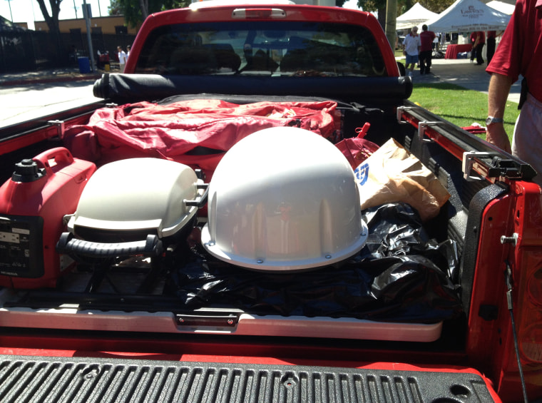 Image: Tailgater Bob Perlberg packs a flat-screen TV, food, a generator, barbecue, three tables and 13 chairs in back of his Dodge Dakota.