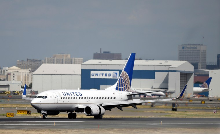 Image: A United Airlines passenger plane lands at Newark Liberty International Airport