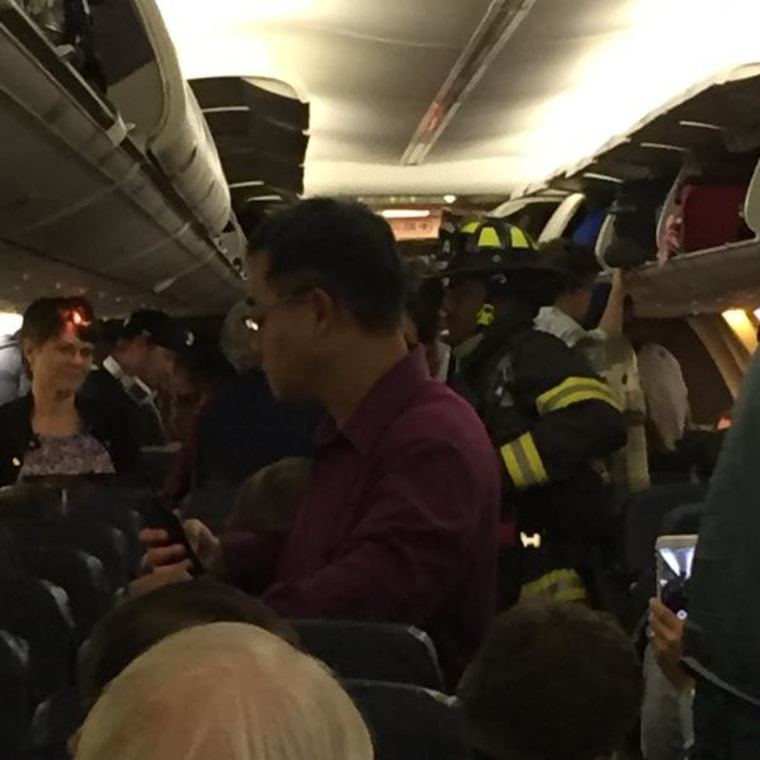 Passengers aboard a Southwest flight taking from Denver to Seattle after the flight was forced to make an emergency landing on Friday night due to a smell of smoke in the cabin.