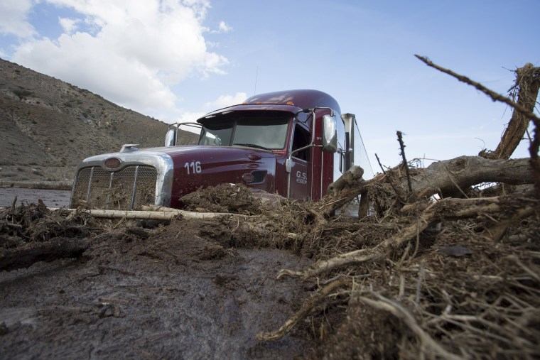 Image: A truck remains mired in mud and debris on State Route 58 near Tehachapi, California