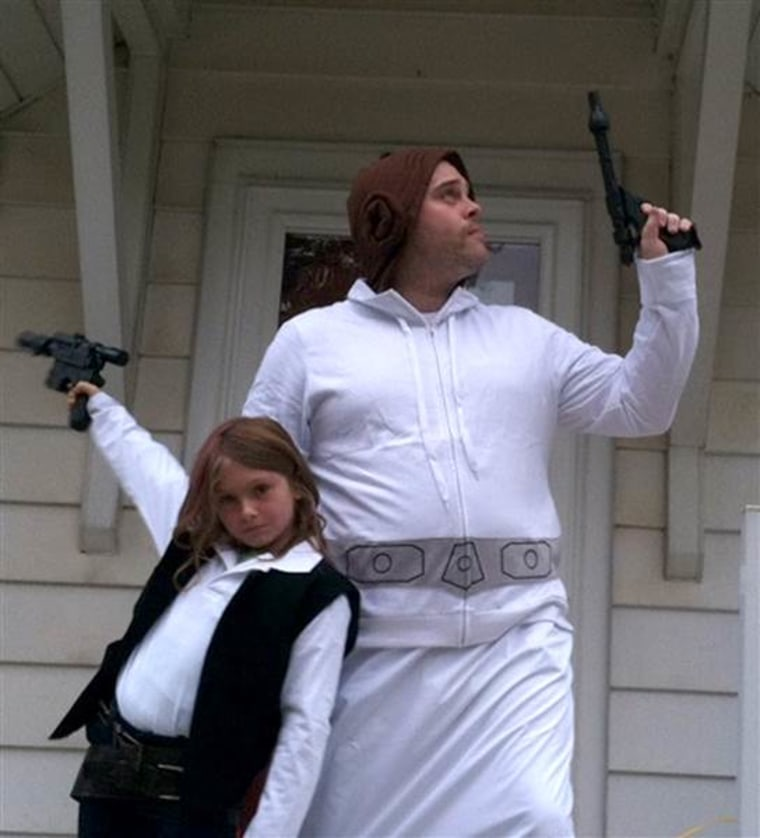 Tom Burns dressed as Princess Leia to complement his daughter's Han Solo costume.