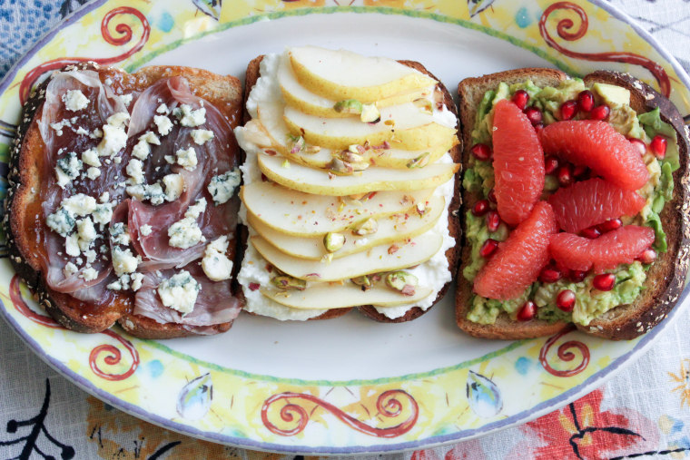 Group shot of creative toasts: prosciutto, fig and blue cheese; ricotta and pear; avocado, grapefruit and pomegranate seeds